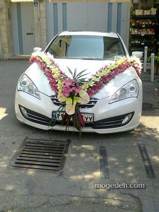 ماشین عروس با گل و تور